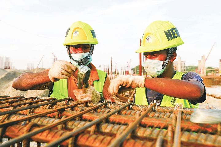 the workers are working on the third terminal building of hazrat shahjalal international airport.