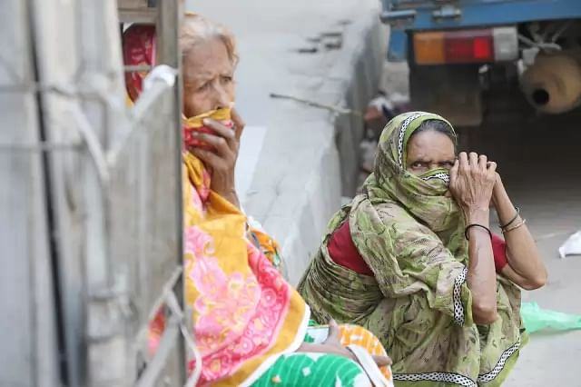 Two elderly women wait for relief at Elephant Road area on 6 April. Photo: Abdus Salam