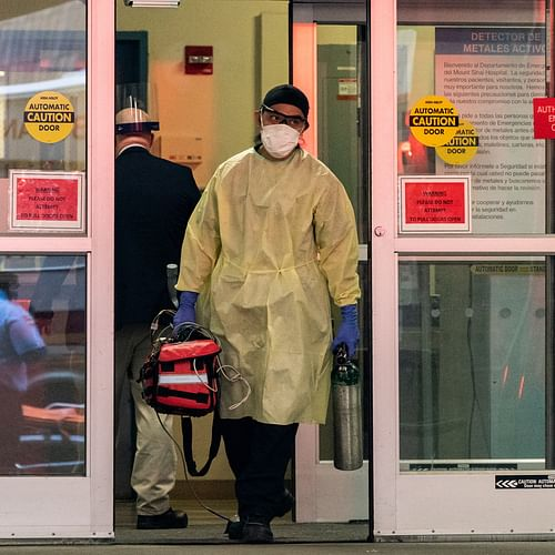 A healthcare worker wearing a protective mask is seen outside at Mount Sinai Hospital during the outbreak of the coronavirus disease (COVID-19) in New York City, US, 4 April 2020.
