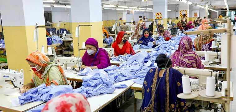 Women work in a garment factory, as factories reopened after the government has eased the restrictions amid concerns over the coronavirus disease (COVID-19) outbreak in Dhaka, Bangladesh, on 3 May 2020