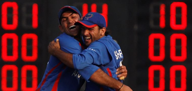 Afghanistan's Shinwarai and Shafaq celebrate the wicket of Bangladesh's Chowdhury during their gold medal cricket match at the 16th Asian Games in Guangzhou.