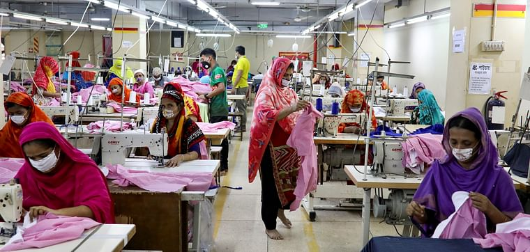 Women work in a garment factory in Dhaka, Bangladesh, on 3 May 2020