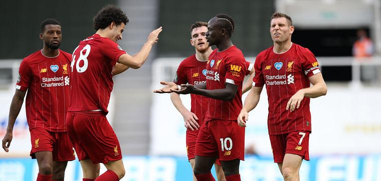 Liverpool's Sadio Mane celebrates scoring their third goal with teammates