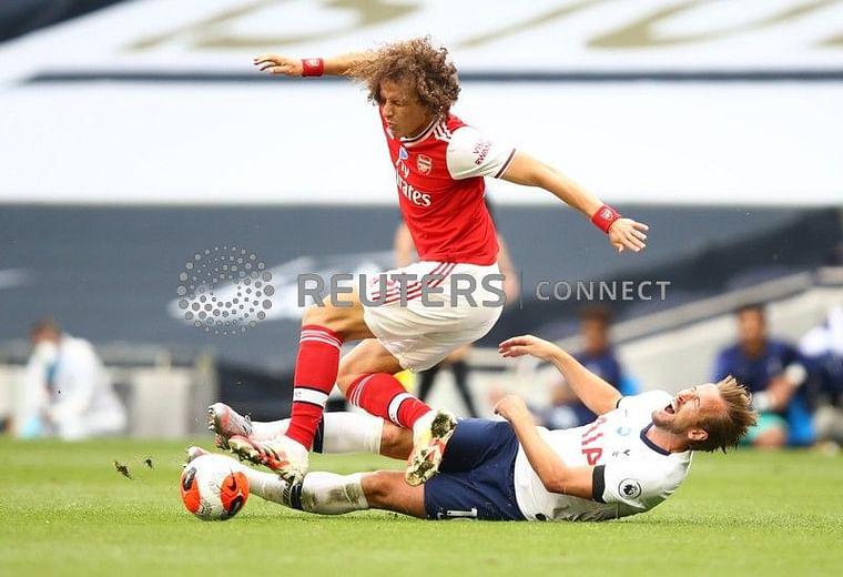 Tottenham Hotspur's Harry Kane in action with Arsenal's David Luiz