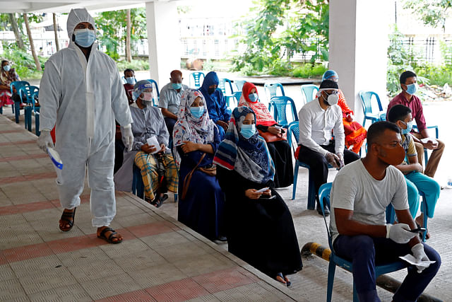 People sit as they come to a coronavirus testing centre in the Mugda Medical College and Hospital as the coronavirus disease (COVID-19) outbreak continues in Dhaka, Bangladesh, on 2 July 2020