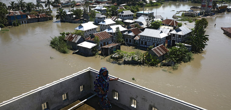 Houses located beside the Padma river are seen flooded as the flood situation worsens in Munshiganj district, on the outskirts of Dhaka, outskirts of Dhaka, Bangladesh, 25 July 2020.