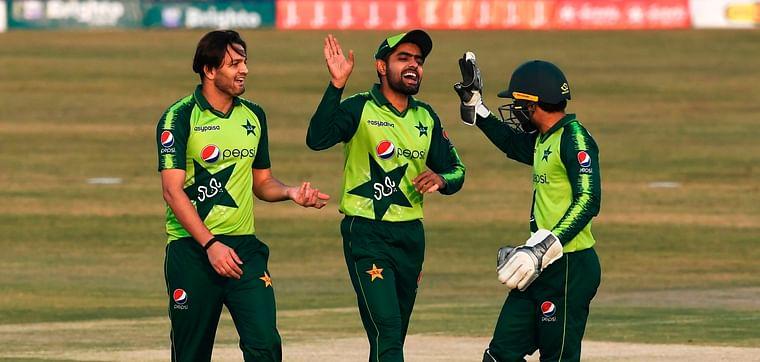 Pakistan's captain Babar Azam (C) celebrates with teammates after the dismissal of Zimbabwe's captain Chamu Chibhabha (not pictured) during the third Twenty20 cricket match between Pakistan and Zimbabwe at the Rawalpindi Cricket Stadium in Rawalpindi on 10 November 2020