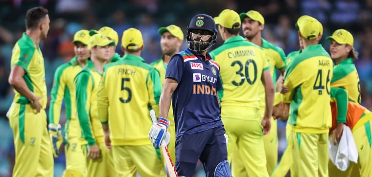 India's captain Virat Kohli (C) reacts as he walks off the ground after being dismissed by Australia's Josh Hazlewood during the one-day cricket match at the Sydney Cricket Ground (SCG) in Sydney on 29 November 2020