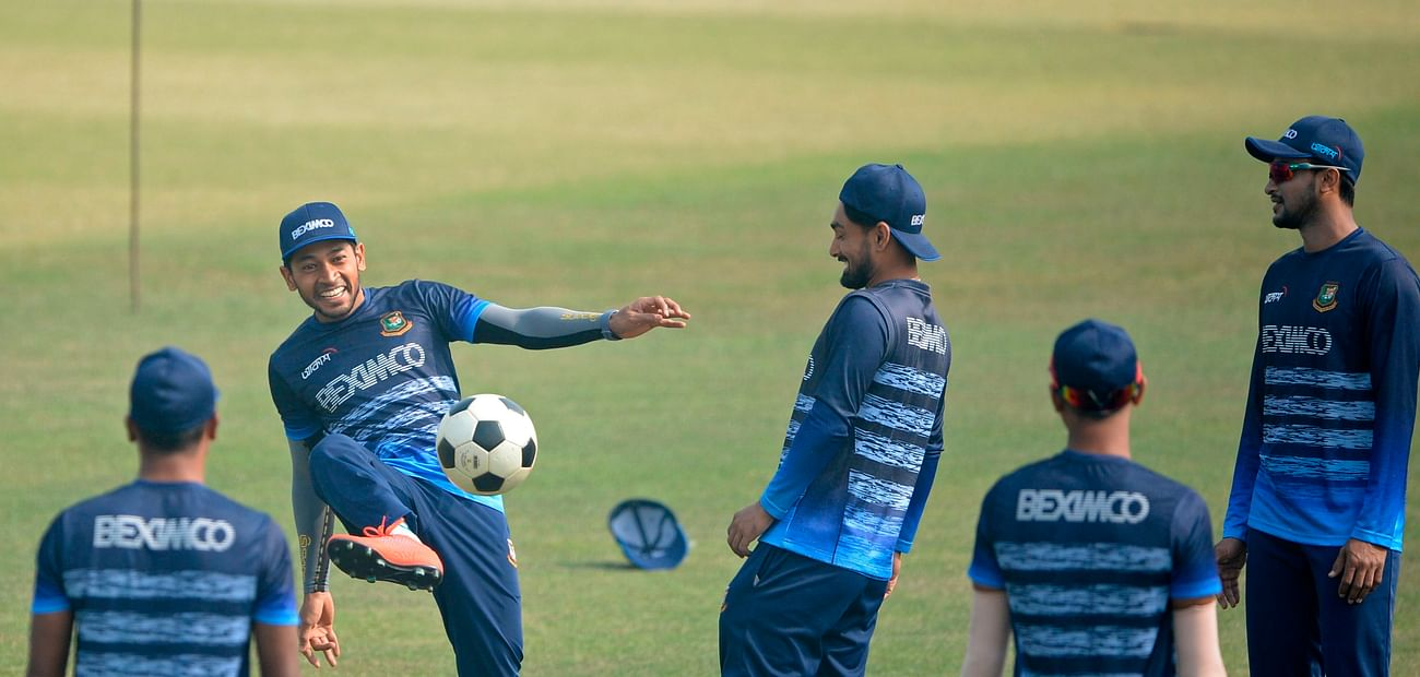 Bangladesh's Mushfiqur Rahim (2L) plays soccer along with his teammates during a practice session at the Zohur Ahmed Chowdhury Stadium in Chittagong in 24 January, 2021