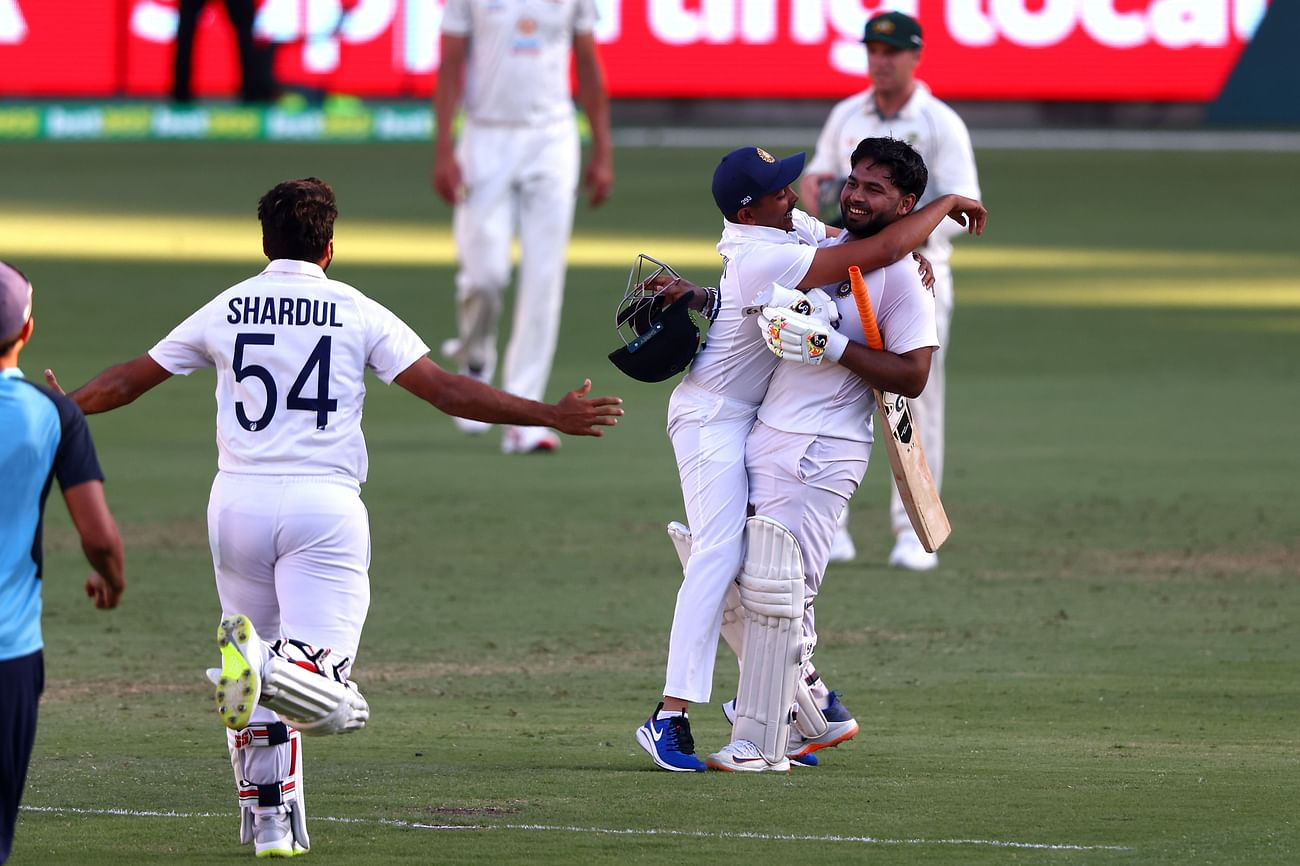 India's batsman Rishabh Pant (R) celebrates victory with teammates in the fourth cricket Test match against Australia at The Gabba in Brisbane on  19 January, 2021