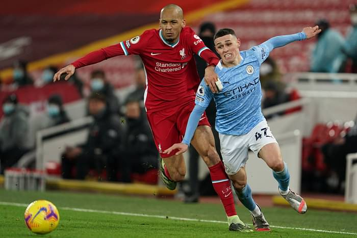 Liverpool's Brazilian midfielder Fabinho (L) vies with Manchester City's English midfielder Phil Foden (R) during the English Premier League football match between Liverpool and Manchester City at Anfield in Liverpool, north west England on 7 February, 2021