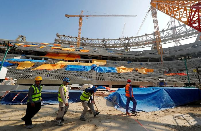 Migrant workers constructing a football stadium in Qatar