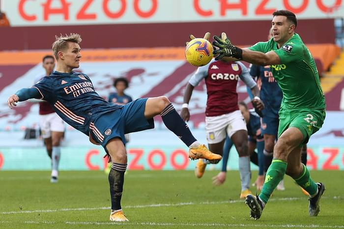 Arsenal's Norwegian midfielder Martin Odegaard (L) vies with Aston Villa's Argentinian goalkeeper Emiliano Martinez during the English Premier League football match between Aston Villa and Arsenal at Villa Park in Birmingham, central England on 6 February, 2021