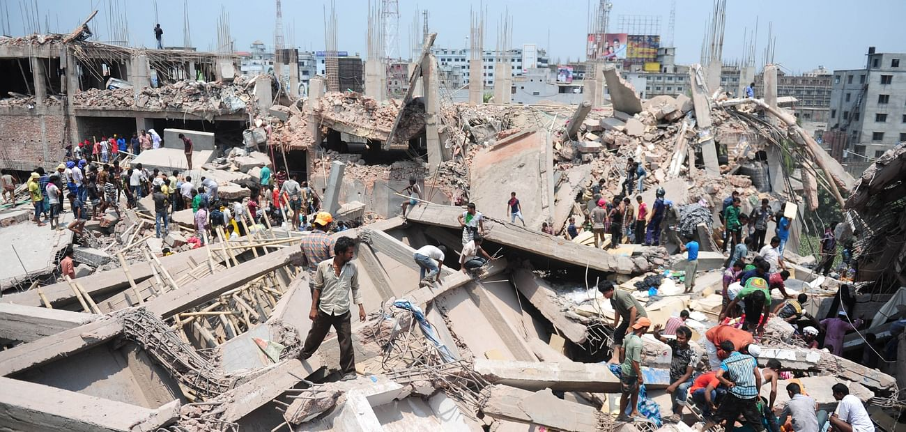 In this photograph taken on 24 April 2013, Bangladeshi civilian volunteers assist in rescue operations after an eight-storey Rana Plaza collapsed in Savar, on the outskirts of Dhaka