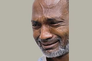 Cartoonist Ahmed Kabir Kishore breaks into tears while recounting the torture he went through