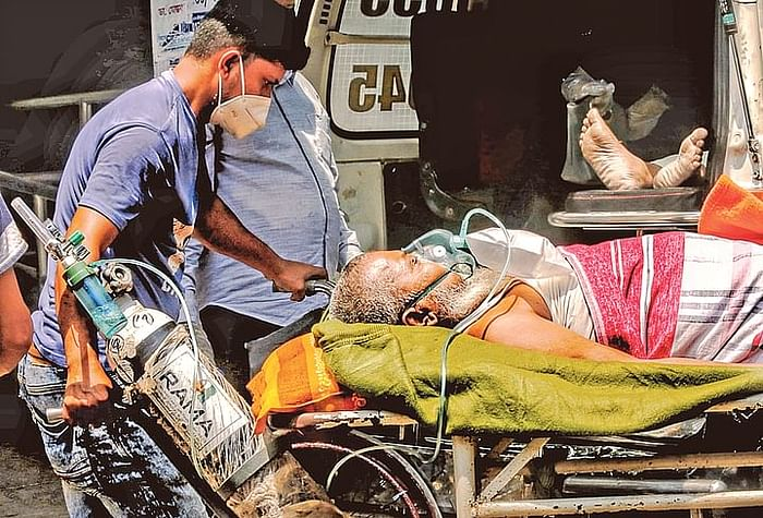 Due to severe breathing problem Azizul Haque was brought to the DMCH from Brahmanbaria. As the ICU beds were not available, he was admitted to the general ward with a separate oxygen cylinder.