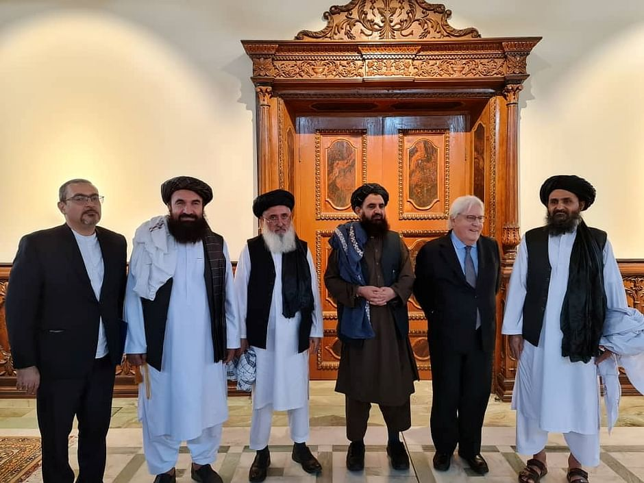 Taliban's Mullah Abdul Ghani Baradar meets with Martin Griffiths, United Nations Under-Secretary-General for Humanitarian Affairs and Emergency Relief Coordinator, in Kabul, Afghanistan, in this handout photo uploaded to social media on 5 September 2021.