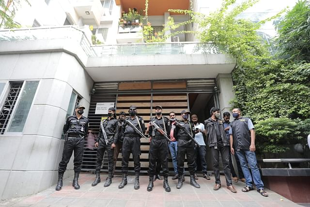 Members of Rapid Action Battalion stand guard in front of Evaly CEO Mohammad Rassel's residence in Dhaka's Mohammadpur during a raid on Thursday, 16 September 2021.