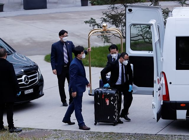Members of the Chinese delegation load baggage into a van in front of the Hyatt Regency Zurich Airport hotel, in Zurich, Switzerland, 6 October 2021.