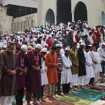 People say their prayers at National Bitul Mukarram Mosque, Dhaka