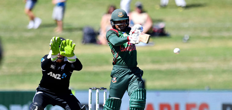 Bangladesh`s Mohammad Mithun plays a shot as New Zealand`s wicketkeeper Tom Latham (L) looks on during the first one-day international (ODI) cricket match between New Zealand and Bangladesh in Napier on 13 February 2019.